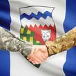 Military handshake and Canadian province flag - Northwest Territ
