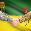 Military handshake and Canadian province flag - Saskatchewan