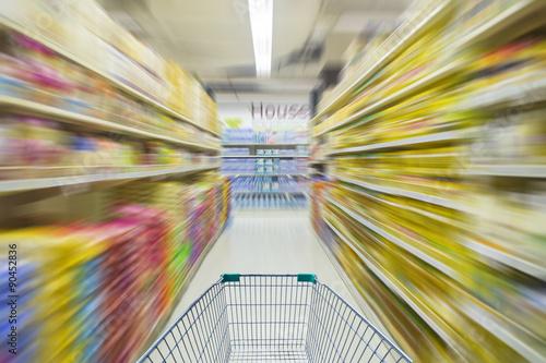 Poster motion blur of supermarket cart in supermarket