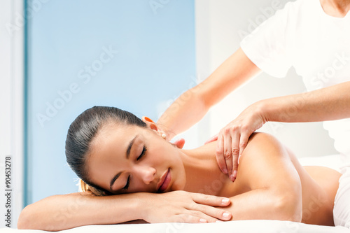 Young woman having spa back massage.