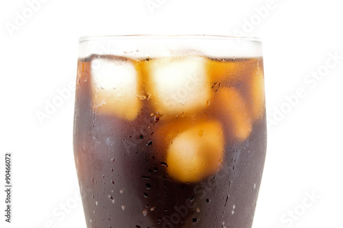 a large glass of cola with ice cubes closeup isolated on white background Poster