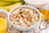 healthy breakfast - oatmeal with banana, honey and walnuts