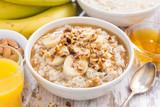 Fototapety healthy breakfast - oatmeal with banana, honey and walnuts
