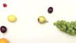 Fresh fruits moving on white background - stop motion animation