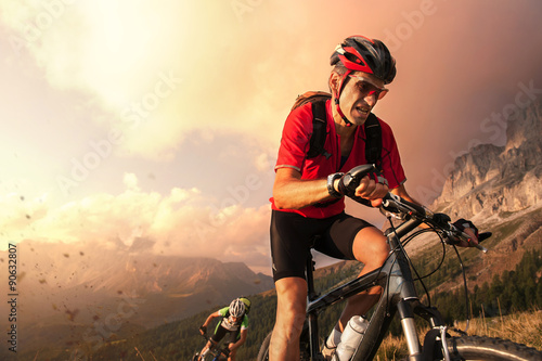 Poszter Cyclists drive fall in the Dolomites and fight