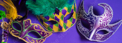 Mardi Gras or carnival mask on purple background