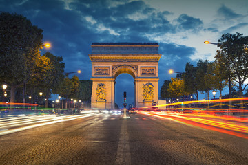 Arc de Triomphe. Image of the iconic Arc de Triomphe in Paris city during twilight blue hour.
