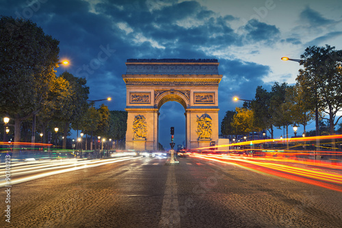 Fridge magnet Arc de Triomphe. Image of the iconic Arc de Triomphe in Paris city during twilight blue hour.