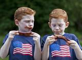Boys eating rib