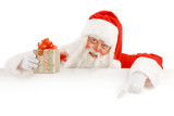 Fototapety Santa Claus Holding a Advertising Space