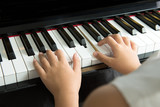 Fototapety Little girl playing piano