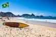 Quadro Brazilian flag and surfboard  at Copacabana Beach, Rio de Janeir