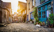 Old town in Europe at sunset with retro vintage Instagram style filter and lens flare effect