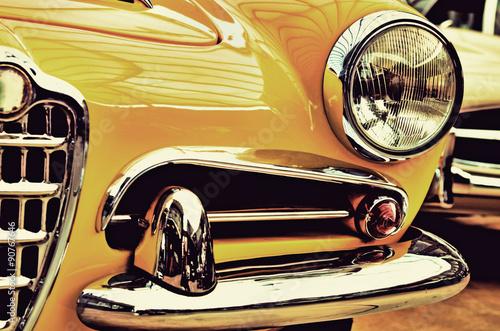 Zdjęcia The hood, bumper, headlight and radiator of stylish yellow vinta