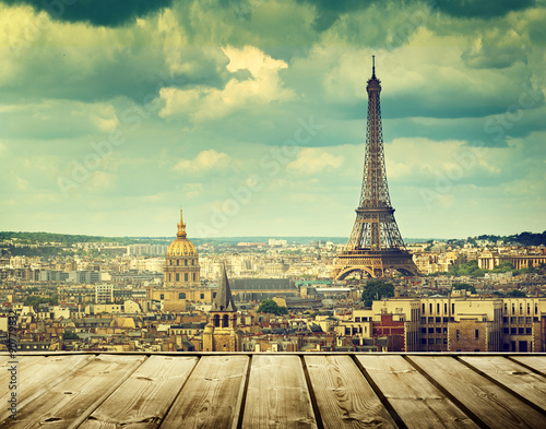 Poster background with wooden deck table and Eiffel tower in Paris