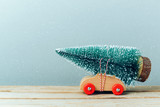 Fototapety Christmas tree on toy car. Christmas holiday celebration concept