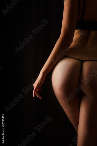 Poster Sexy butt girls in underwear over black background