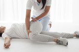Physio Therapist have stretch a woman's waist - 90797883