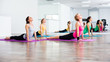 Four girls practicing yoga, Bhujangasana / Cobra Pose