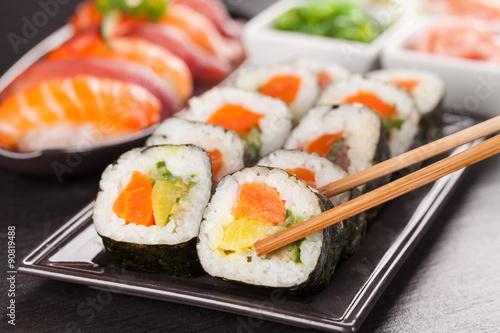Zdjęcia na płótnie, fototapety na wymiar, obrazy na ścianę : sushi pieces with chopsticks