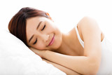 Fototapety beautiful young  woman  sleep on the bed