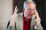 Angry man yelling on the phone