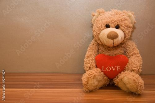 obraz PCV Teddy bear with a red heart