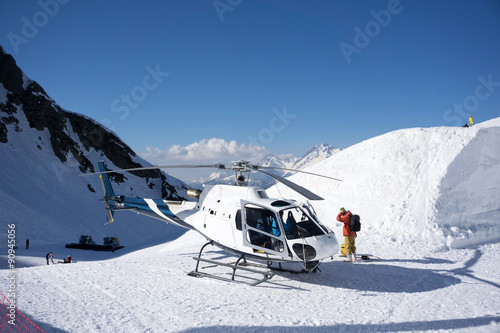 obraz lub plakat White rescue helicopter parked in the mountains