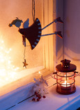 Christmas decoration in night on old window. Selective focus