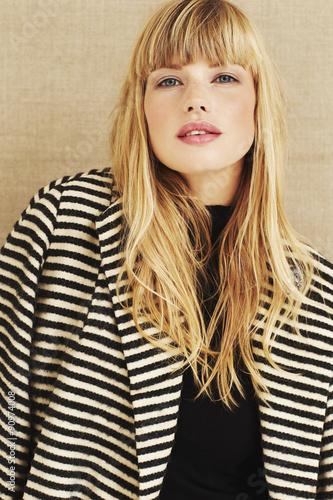 Beautiful blond woman in coat, portrait © sanneberg