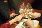 Four women who have been toast with white wine