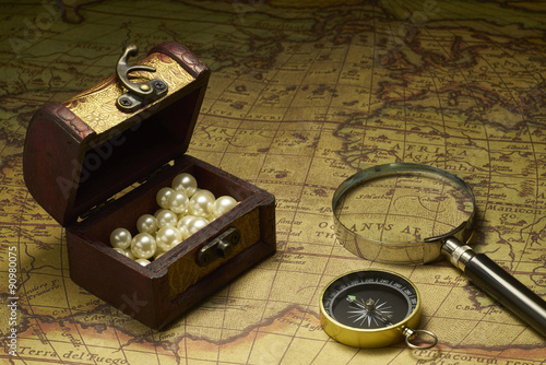 Poszter Old compass and Magnifier on vintage map