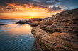 Rocky sunrise. Sea sunrise at the Black Sea coast near Ravda, Bulgaria