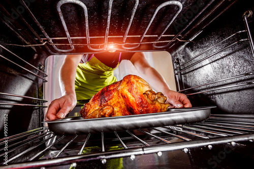 Fotobehang Koken Cooking chicken in the oven at home.