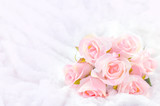 Fototapety Pastel Coloured Artificial Pink Rose on white fur background