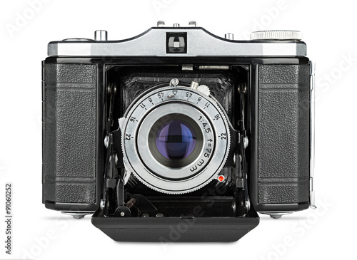 old retro bellows photo camera isolated on white background © stockphoto-graf