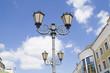 Постер, плакат: Городские осветительные фонари на фоне синего неба