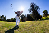 Golf sport: golfer hits a shoot from the fairway