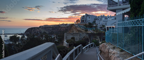 Foto op Canvas Caraïben Panoramic view of overlook of the harbor walkway in Dana Point, California, at sunset in Summer