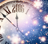 2016 New year clock with snowy background.