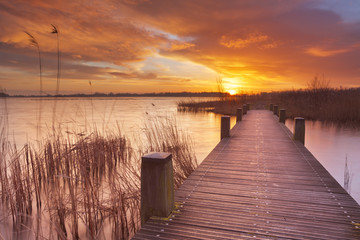 Boardwalk over water at sunrise, near Amsterdam The Netherlands © sara_winter