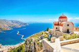 Remote church with red roofing on cliff, Greece - 91127259