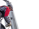 repairman on a telecommunications tower. repairman on a telecommunications tower installs transmitter mobile
