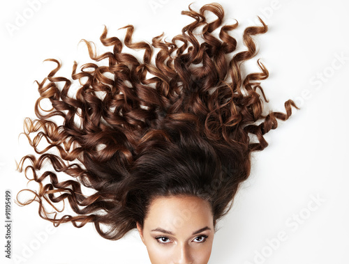 Poster, Tablou curly hair and part of woman's face, looking at the camera