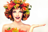 Fototapety Autumn Beauty - fashion Makeup With Red and yellow autumn Leaves on  girl head . Emotions and surprise on the face of the autumn girl
