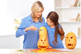 Mother and daughter preparing for Halloween