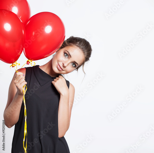 Poster Smiling girl with balloons on a white background isolated