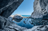 Fototapety sea cave rocks. Grotto with water reflections