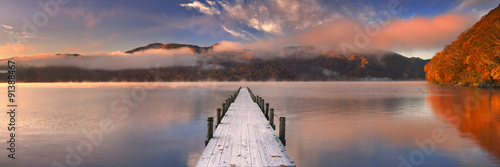Fotobehang Pier Jetty in Lake Chuzenji, Japan at sunrise in autumn