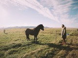 man in front of beautiful black islandic horse